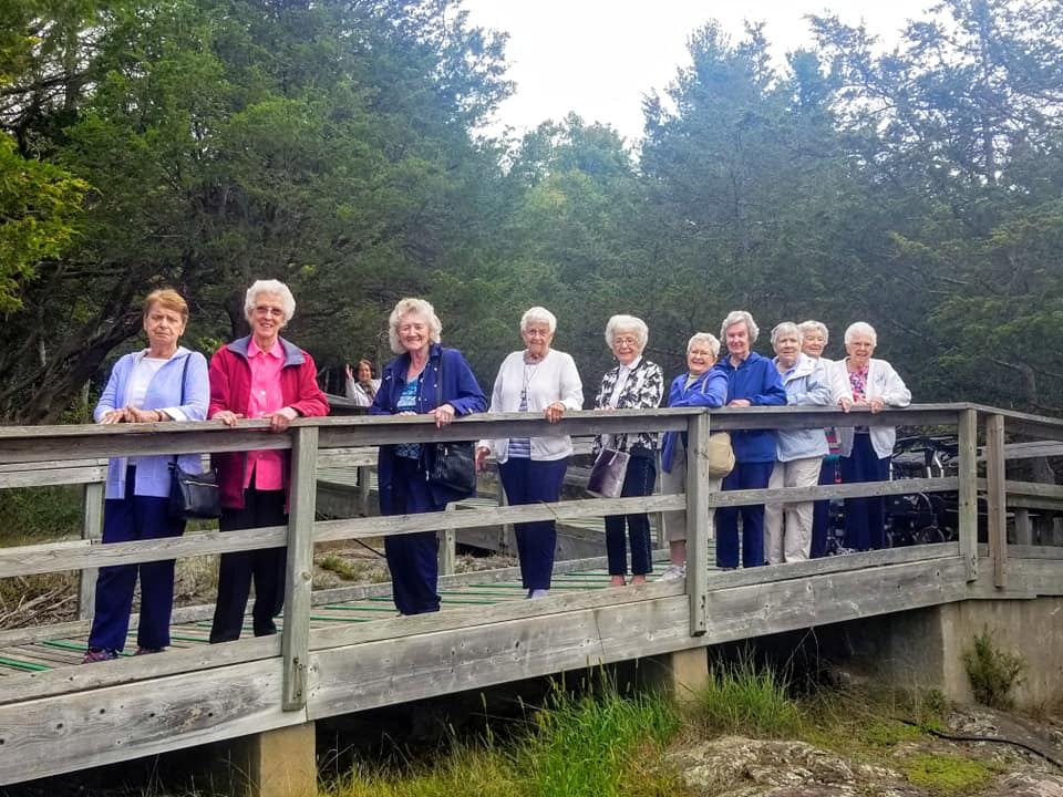 Women standing on bridge during Stirling Park Retirement Community Event